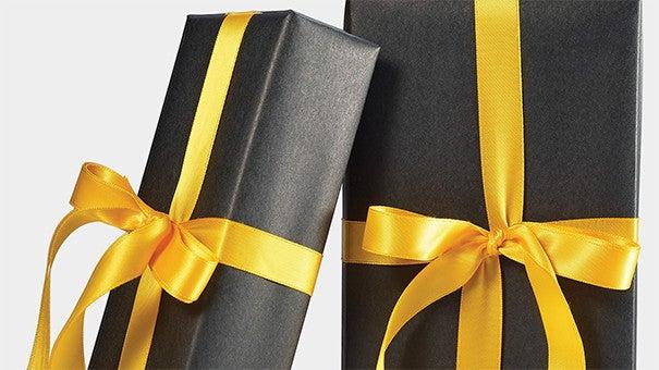 Black gift box with yellow ribbon.