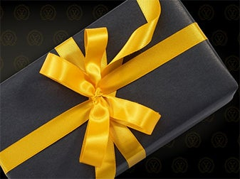 Black gift box with yellow ribbon.