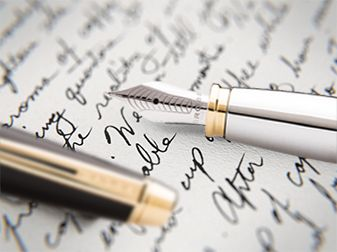 Close up image of script and fountain pen nib.